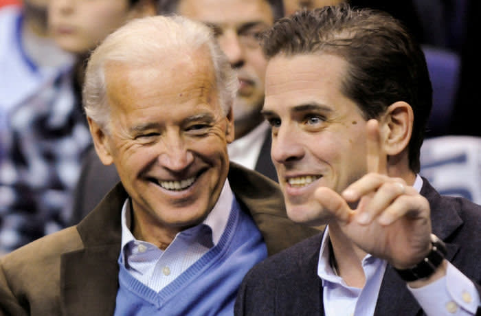 FILE PHOTO: U.S. Vice President Joe Biden and his son Hunter Biden attend an NCAA basketball game between Georgetown University and Duke University in Washington, U.S., January 30, 2010. REUTERS/Jonathan Ernst -/File Photo