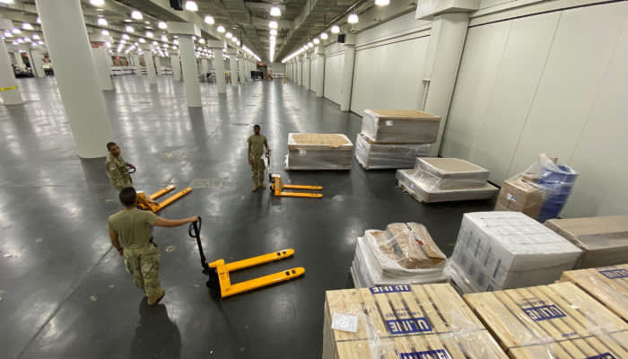 New York Army National Guard Soldiers of the 133rd Composite Supply Company with initial shipments of a FEMA Field Hospital set up at the Jacob Center in New York City