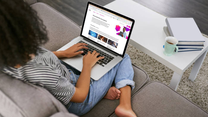 Shot of a young woman using a laptop on the sofa at home