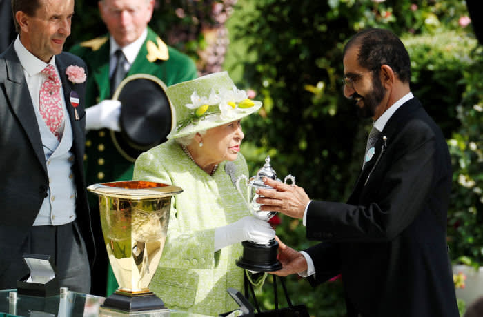 Horse Racing - Royal Ascot - Ascot Racecourse, Ascot, Britain - June 22, 2019 Britain's Queen Elizabeth presents Dubai's ruler Sheikh Mohammed bin Rashid al-Maktoum with a trophy for the winning owner of the 4.20 Diamond Jubilee Stakes Action Images via Reuters/John Sibley - RC1B88D97330