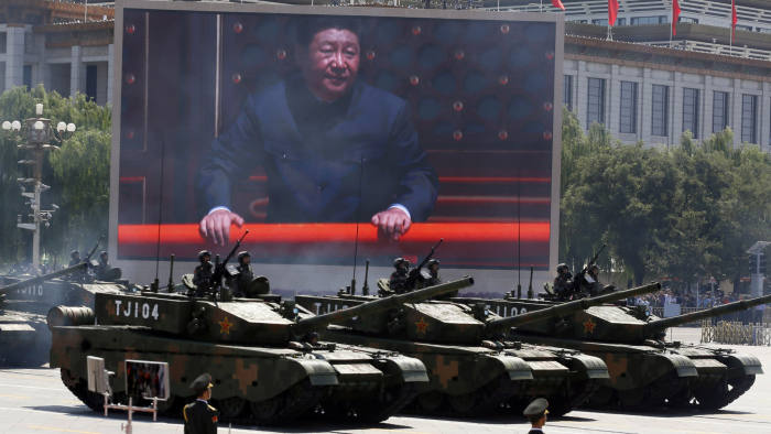 "FILE - In this Sept. 3, 2015, file photo, Chinese President Xi Jinping is displayed on a screen as Type 99A2 Chinese battle tanks take part in a parade commemorating the 70th anniversary of Japan's surrender during World War II held in front of Tiananmen Gate in Beijing. Xi has an ambitious goal for China: to achieve ""national rejuvenation"" as a strong and prosperous nation by 2049, which would be the 100th anniversary of Communist Party rule. One problem: U.S. President Donald Trump wants to make the United States great again too. (AP Photo/Ng Han Guan, File)"