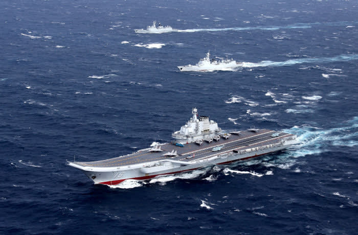 FILE PHOTO: China's Liaoning aircraft carrier with accompanying fleet conducts a drill in an area of South China Sea, in this undated photo taken December, 2016. REUTERS/Stringer/File photo ATTENTION EDITORS - THIS IMAGE WAS PROVIDED BY A THIRD PARTY. EDITORIAL USE ONLY. CHINA OUT TPX IMAGES OF THE DAY