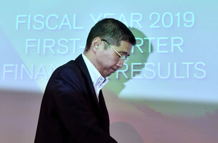 (FILES) In this file photo taken on July 25, 2019 Nissan Motors CEO Hiroto Saikawa leaves a press conference after announcing first quarter financial results at the company headquarters in Yokohama. - The CEO of crisis-hit Japanese automaker Nissan admitted on September 5, 2019 he received more pay than he was entitled to but denied wrongdoing, as the firm's former chief faces financial misconduct charges. (Photo by TOSHIFUMI KITAMURA / AFP)TOSHIFUMI KITAMURA/AFP/Getty Images