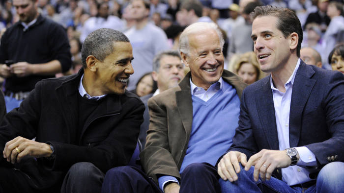 FILE - This Jan. 30, 2010 file photo shows Hunter Biden, right, son of Vice President Joe Biden, center, talking with President Barack Obama, and the vice president Joe Biden during a college basketball game in Washington. Biden's youngest son Hunter is joining the Navy. The Navy says the attorney and former Washington lobbyist was selected to be commissioned into the Navy Reserve as a public affairs officer. Because he is 42, he needed a special waiver to be accepted, but that is not uncommon. He is one of seven candidates recommended for a direct commission for public affairs. (AP Photo/Nick Wass, File)