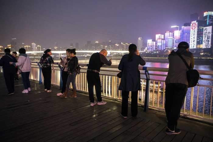 CHONGQING, CHINA - 3 APRIL 2019. People enjoy scenery of Hongyadong area at night. (Giulia Marchi for The Financial Times) pfeatures