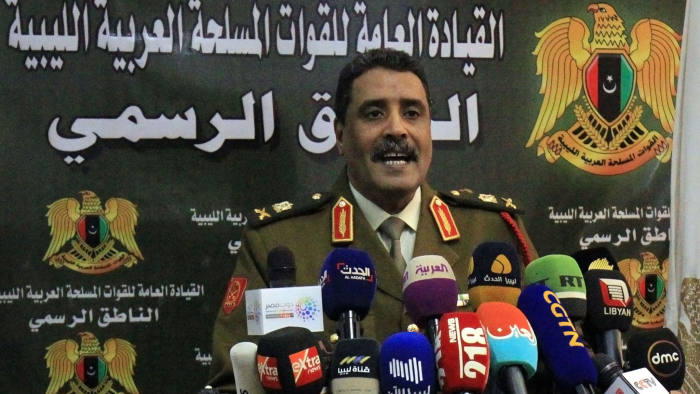 Ahmad al-Mesmari, spokesman for Haftar's forces, addresses the media in the eastern Libyan city of Benghazi on January 6, 2020. - Forces of Libyan strongman Khalifa Haftar announced they had taken control of the coastal city of Sirte from factions loyal to the Tripoli government. Sirte, some 450 kilometres (280 miles) east of the capital Tripoli, had been held by forces allied with the UN-recognised Government of National Accord (GNA) since 2016. (Photo by Abdullah DOMA / AFP) (Photo by ABDULLAH DOMA/AFP via Getty Images)