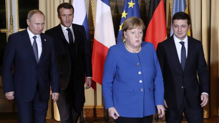 French President Emmanuel Macron, second left, Russian President Vladimir Putin, left, German Chancellor Angela Merkel and Ukrainian President Volodymyr Zelenskiy arrive for a working session at the Elysee Palace Monday, Dec. 9, 2019 in Paris. Russian President Vladimir Putin and Ukraine's president are meeting for the first time at a summit in Paris to find a way to end the five years of fighting in eastern Ukraine. (AP Photo/Thibault Camus, Pool)