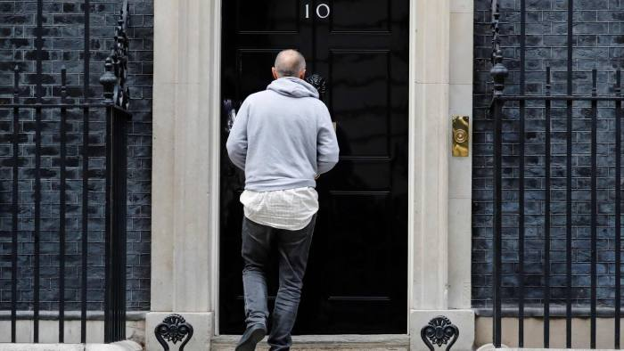 Special Advisor to Britain's Prime Minister, Dominic Cummings, uses his phone as he returns back to 10 Downing Street in central London on September 10, 2019. - Beleaguered British Prime Minister Boris Johnson vowed to continue with his attempts to strike a new Brexit deal with Brussels, after losing yet another parliamentary vote to hold an early election. (Photo by Tolga AKMEN / AFP)TOLGA AKMEN/AFP/Getty Images