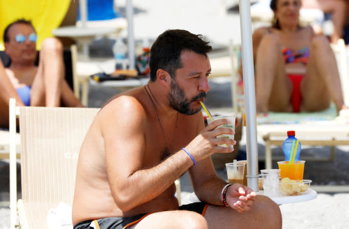 Italian Interior Minister and leader of the League party Matteo Salvini enjoys a refreshment at the Caparena beach in the Sicilian seaside town of Taormina, Italy, August 11, 2019. REUTERS/Antonio Parrinello