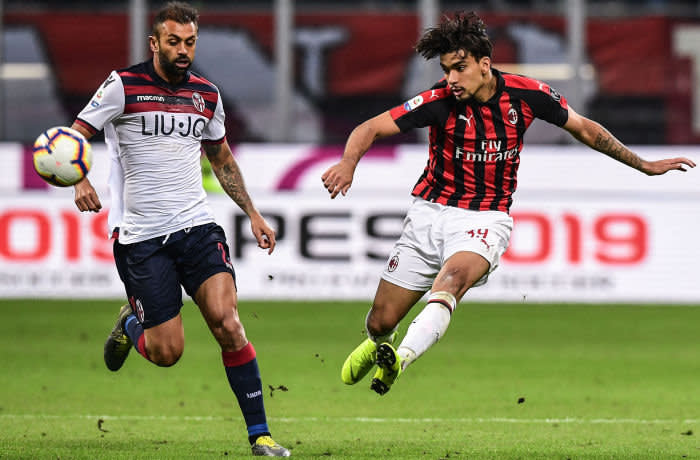 AC Milan's Brazilian midfielder Lucas Paqueta (R) shoots on goal during the Italian Serie A football match AC Milan vs Bologna on May 6, 2019 at the San Siro stadium in Milan. (Photo by Miguel MEDINA / AFP) (Photo credit should read MIGUEL MEDINA/AFP/Getty Images)