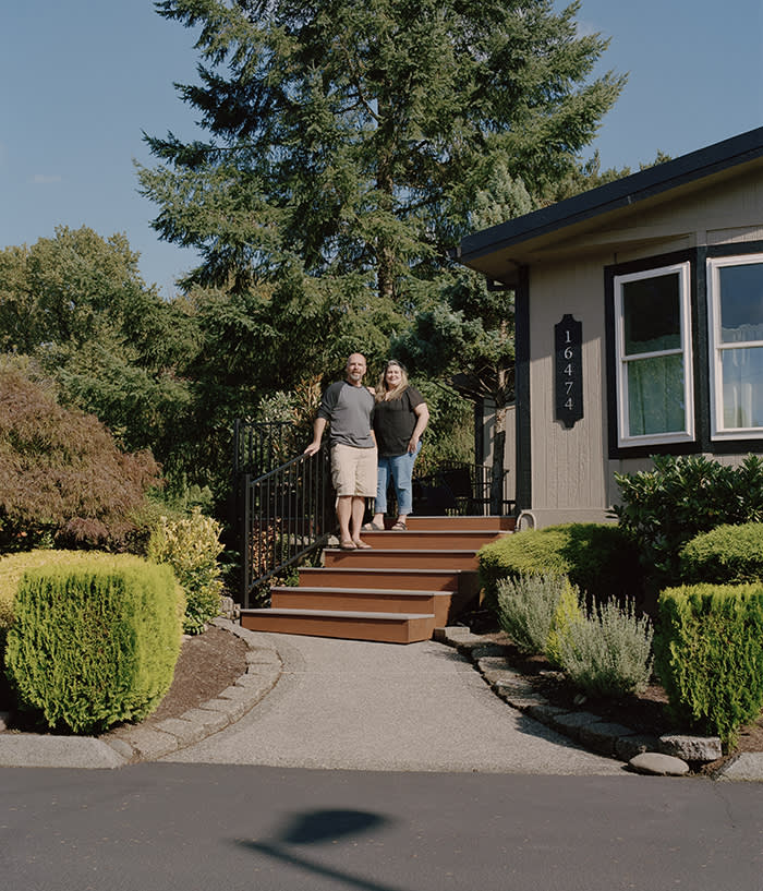 Greg and Elizabeth Lindstrom outside their manufactured home at the Clackamas River Community Cooperative. 'It's a secure, friendly community,' says Greg. 'We won't be moving ever again'