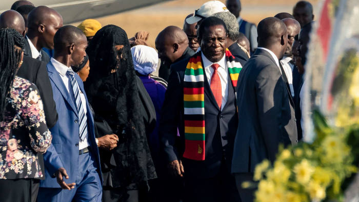 Zimbabwean President Emmerson Mnangagwa (C-R) stands by former first lady Grace Mugabe (C-L) at the Robert Mugabe International Airport in Harare after the arrival of the body of former President Robert Mugabe on September 11, 2019. - The body of Zimbabwe's ex-president, Robert Mugabe, arrived home on September 11, 2019 for burial in a country divided over the legacy of a former liberation hero whose 37-year rule was marked by repression and economic ruin. (Photo by Jekesai NJIKIZANA / AFP)JEKESAI NJIKIZANA/AFP/Getty Images