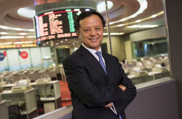 Charles Li, chief executive officer of Hong Kong Exchanges & Clearing Ltd. (HKEx), poses for a photograph following a Bloomberg Television interview at the Hong Kong Stock Exchange in Hong Kong, China on Monday, Dec. 5, 2016. Hong Kong's second stock-trading connect with the mainland may be followed by links for initial public offerings, bonds and commodities, said Li. Photographer: David Paul Morris/Bloomberg