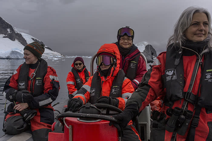 Scientists and Greenpeace crew members on board a dinghy in the Errera Channel. As well as counting penguins, they also gather samples of plankton and conduct environmental DNA testing to find out which species are in the water
