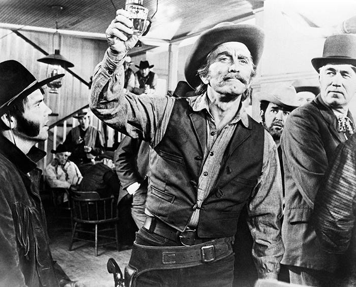 Kirk Douglas in a scene from the film A Gunfight, in which he takes part in a duel in a Mexican village.