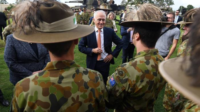 epa06601839 Australian Prime Minister Malcolm Turnbull talks to a group of soldiers from the 7th Brigade after inspecting a Boxer CRV armoured vehicle (at rear) at the Gallipoli Barracks in Brisbane, Australia, 14 March 2018. Turnbull announced a AUD $5 billion contract to build 211 of the light armoured vehicles at a new facility in Ipswich, west of Brisbane. EPA/DAN PELED AUSTRALIA AND NEW ZEALAND OUT