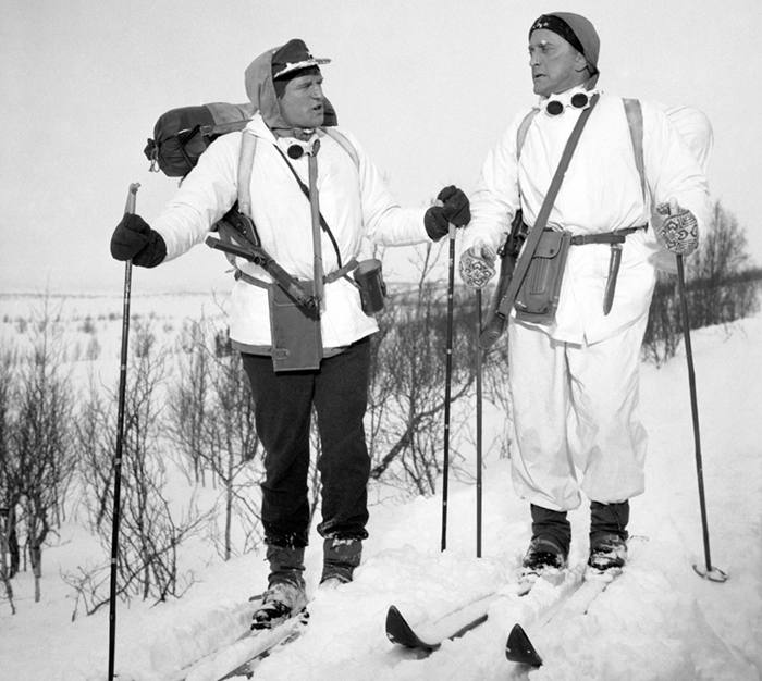 Actors Richard Harris (left) and Kirk Douglas plough through heavy snow in Norway, while on location for the war film The Heroes of Telemark.
