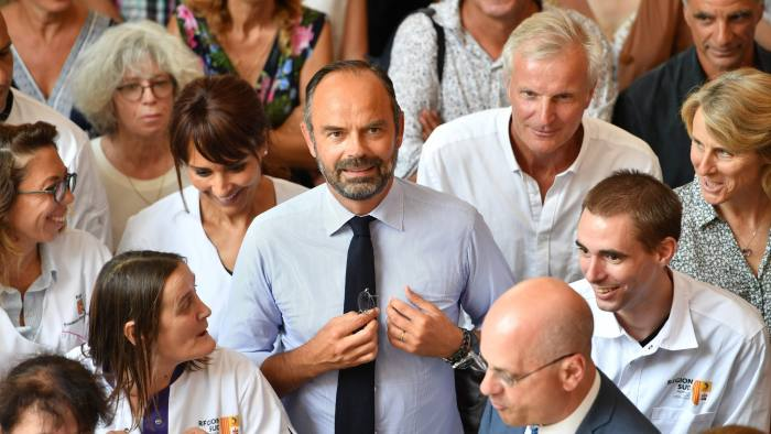 "French Prime Minister Edouard Philippe (C) and French Education and Youth Affairs Minister Jean-Michel Blanquer (C,R) pose with teachers after attending a presentation of new teaching methods at the Val d'Argens ""polyvalent"" high school in Le Muy, south eastern France, on August 30, 2019. (Photo by Yann COATSALIOU / AFP)YANN COATSALIOU/AFP/Getty Images"