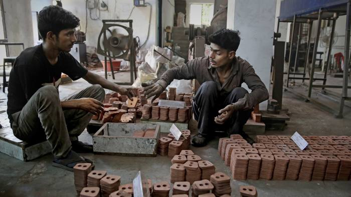 In this Thursday, Sept. 5, 2019, photo, Indian workers prepare packing of clutch buttons at an auto component manufacturing factory on the outskirts of New Delhi, India. Confidence in the Indian economy is giving way to uncertainty as growth in the labor-intensive manufacturing sector has come to a near standstill, braking to 0.6% in the last quarter from 12.1% in the same period a year earlier. (AP Photo/Altaf Qadri)