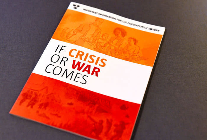 """The new brochure """"If Crisis or War Comes"""" of Swedish Civil Contingencies Agency is pictured during a press conference in Stockholm, on May 21, 2018. - The Swedish government on Monday, May 21, 2018, presented an emergency pamphlet to prepare citizens in the event of a war, natural disaster or cyber attack amid soaring tensions between Russia and the Western allies. (Photo by Pontus LUNDAHL / TT News Agency / AFP) / Sweden OUT (Photo credit should read PONTUS LUNDAHL/AFP via Getty Images)"""