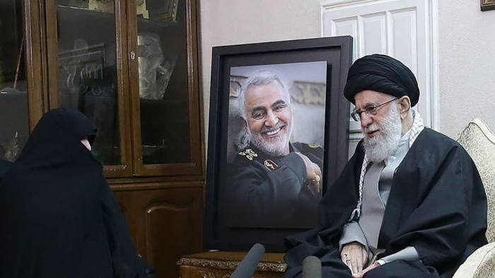 "A handout picture provided by the office of Iran's Supreme Leader Ayatollah Ali Khamenei on January 3, 2020, shows him (R) visiting the family of killed Iranian Revolutional Guards commander Qasem Soleimani, in the capital Tehran. - A furious Iran threatened to avenge a US strike that killed the top Iranian commander at Baghdad's international airport early in the morning, raising fears of a wider regional conflict between the arch-foes. To his fans and enemies alike, Soleimani was the key architect of Iran's regional influence, leading the fight against jihadist forces and extending Iran's diplomatic heft in Iraq (Photo by - / KHAMENEI.IR / AFP) / === RESTRICTED TO EDITORIAL USE - MANDATORY CREDIT ""AFP PHOTO / HO / KHAMENEI.IR"" - NO MARKETING NO ADVERTISING CAMPAIGNS - DISTRIBUTED AS A SERVICE TO CLIENTS === (Photo by -/KHAMENEI.IR/AFP via Getty Images)"