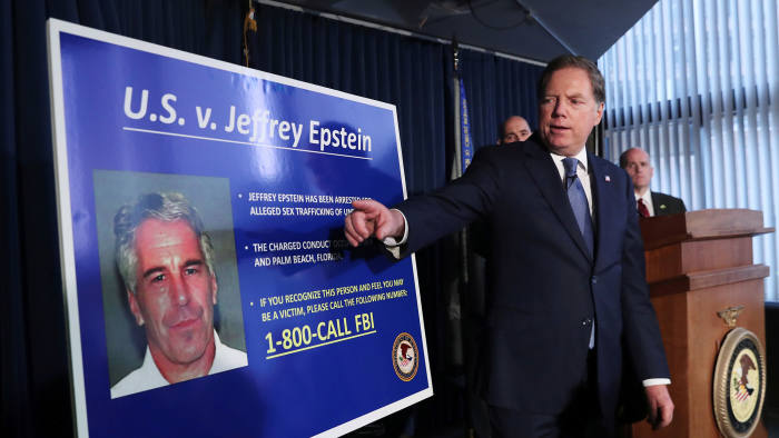 Geoffrey Berman, US attorney for the southern district of New York, points to a photograph of Jeffrey Epstein as he announces the financier's charges of sex trafficking of minors and conspiracy to commit sex trafficking of minors, in New York, U.S., July 8, 2019