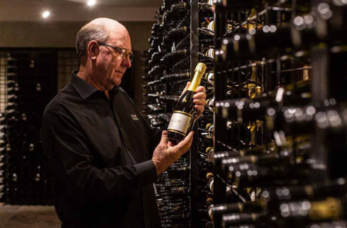 Graeme Shaw inspecting a bottle of wine