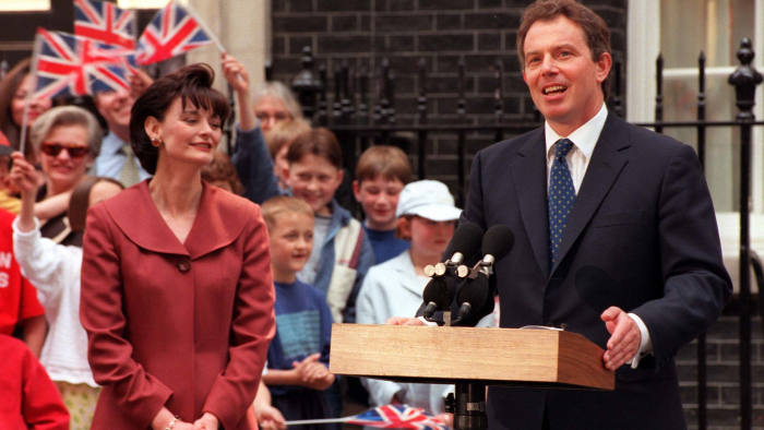 Cherie Blair looks on as her husband, Tony Blair, addresses the nation for the first time as Prime Minister in Downing Street. Labour ousted the Tories from 18 years of government with a landslide general election victory.