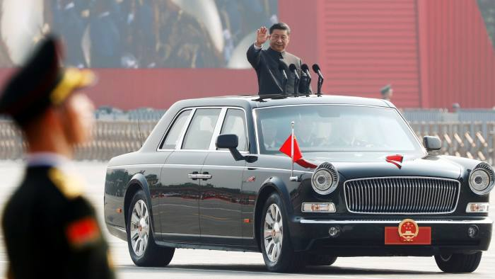 Chinese President Xi Jinping waves from a vehicle as he reviews the troops at a military parade marking the 70th founding anniversary of People's Republic of China, on its National Day in Beijing, China October 1, 2019. REUTERS/Thomas Peter