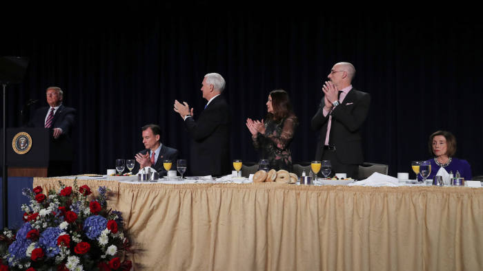 U.S. President Donald Trump delivers a speech as Vice President Mike Pence, his wife Karen Pence and House Speaker Nancy Pelosi (D-CA) look on at the National Prayer Breakfast in Washington, U.S., February 6, 2020. REUTERS/Leah Millis