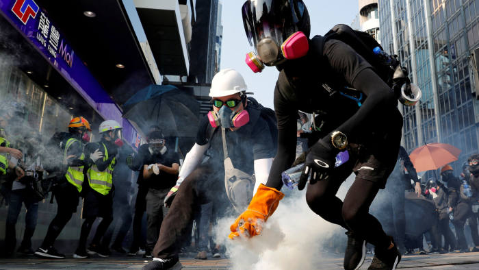 FILE PHOTO: An anti-government protester holds a tear gas canister during a protest in Hong Kong, China October 20, 2019. REUTERS/Tyrone Siu/File Photo To match Special Report HONGKONG-PROTESTS/TYCOONS