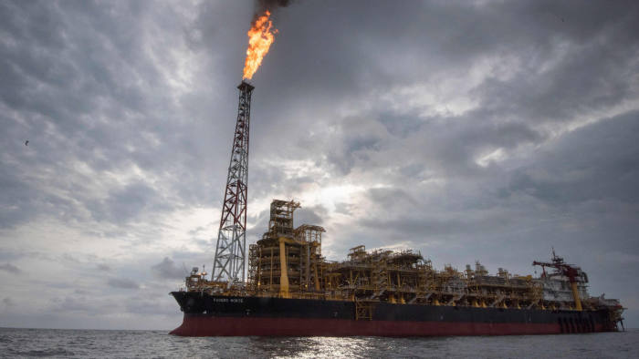TOPSHOT - A view of the Kaombo Norte, a Floating Production Storage and Offloading vessel (FPSO), a project operated by Total, the French multinational oil company, on November 8, 2018, about 250km off the coast of Angola in the Atlantic Ocean. - A column of flame emanates from the bow of the boat, illuminating the jet-black ocean for miles around. For three months now the Kaombo Norte has been anchored off the northern coast of Angola and has recently begun to pump up crude oil secreted in the depths below. The arrival of the platform ship which belongs to French oil giant Total has been a timely lifeline for the Angolan government. (Photo by Rodger BOSCH / AFP)RODGER BOSCH/AFP/Getty Images