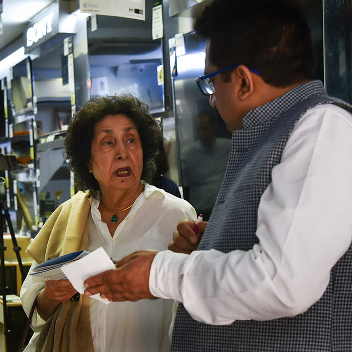 Customers Ashok Bahal (left) and his wife Pearl (centre) discuss their purchase of air-purifiers at an electronics retail store in Delhi's Khanna market on 6th November, 2019.