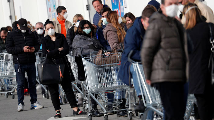People queue at a supermarket in one of the quarantined areas in northern Italy