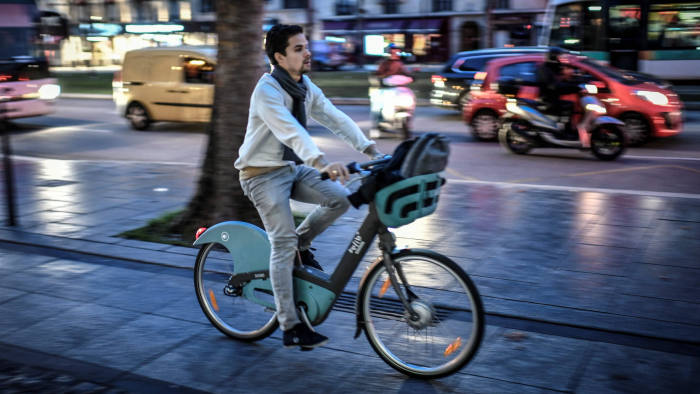 A man rides a bicycle in Paris, on December 19, 2019, on the 15th day of nationwide multi-sector strikes against the planned reform. - French officials met with union leaders on December 18, 2019 hoping to end an impasse over a hotly contested pensions overhaul, 15 days into a crippling transport strike that is casting a shadow over holiday travel plans. (Photo by STEPHANE DE SAKUTIN / AFP) (Photo by STEPHANE DE SAKUTIN/AFP via Getty Images)