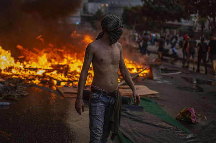 Demonstrators erect a flaming barricade during clashes with security forces in Beirut, Oct. 18, 2019. Lebanon's protests, the largest since its independence, have moved from fury over the economy and corruption to demands for a new political system. (Diego Ibarra Sanchez/The New York Times) Credit: New York Times / Redux / eyevine For further information please contact eyevine tel: +44 (0) 20 8709 8709 e-mail: info@eyevine.com www.eyevine.com
