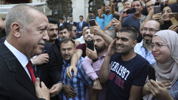 Turkey's President Recep Tayyip Erdogan speaks to his supporters after Friday prayers in Istanbul, Sept. 13, 2019, shortly after former Prime Minister Ahmet Davutoglu announced his resignation from Erdogan's ruling Justice and Development Party, or AKP, in Ankara, Turkey. Davutoglu has also announced plans to form a new political movement.(Presidential Press Service via AP, Pool)