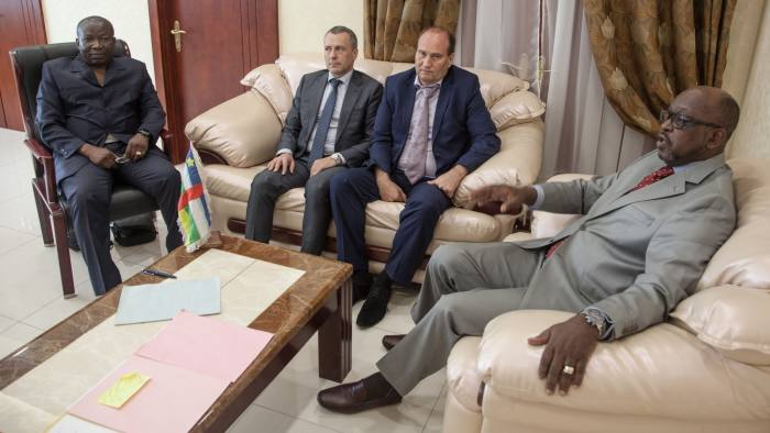 (LtoR) Minister of Public Security Henri Wanzet Linguissara, First Secretary at the Russian Embassy in the Central African Republic Victor Tokmakov, Special Security Advisor to the Central African President Valeriy Zakharov, and Minister of Communication and Government Spokesman Ange Maxime Kazagui, meet in the office of the administrative building, on August 2, 2018 in Bangui. - Russia on August 2, 2018 said no sign of torture was found on the bodies of three Russian journalists killed during a reporting trip in the Central African Republic this week. Journalists Kirill Radchenko, Alexadner Rastorguyev and Orkhan Dzhemal were killed in the strife-torn African country on July 30, 2018. They were reporting on the so-called Wagner Group, a company that sends Russian mercenaries to hotspots such as Syria and Ukraine that has been described as Moscow's shadow army. (Photo by FLORENT VERGNES / AFP) (Photo credit should read FLORENT VERGNES/AFP/Getty Images)