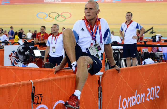 Shane Sutton, coach of Britain's Edward Clancy, observes his race in the London 2012 Olympic Games men's omnium 1km time trial cycling event at the Velodrome in the Olympic Park in East London on August 5, 2012. AFP PHOTO /CARL DE SOUZA (Photo credit should read CARL DE SOUZA/AFP/GettyImages)
