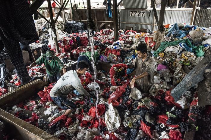 Washing plastic bags at Bantar Gebang, Indonesia