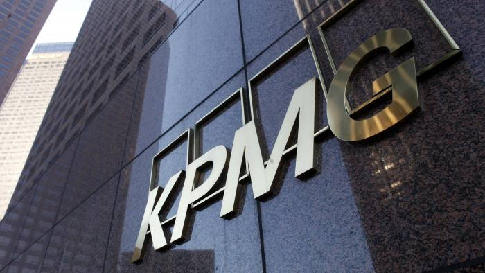 Street level sign on the KPMG building in Downtown Los Angeles...The street level sign of the KPMG buliding in downtown Los Angeles is shown April 10, 2013. In a blow to one of the world's largest accounting firms, KPMG said it resigned as auditor of two U.S. corporations amid an FBI investigation into insider trading allegations involving leaked information and a former senior partner.  REUTERS/Sam Mircovich  (UNITED STATES - Tags: BUSINESS)