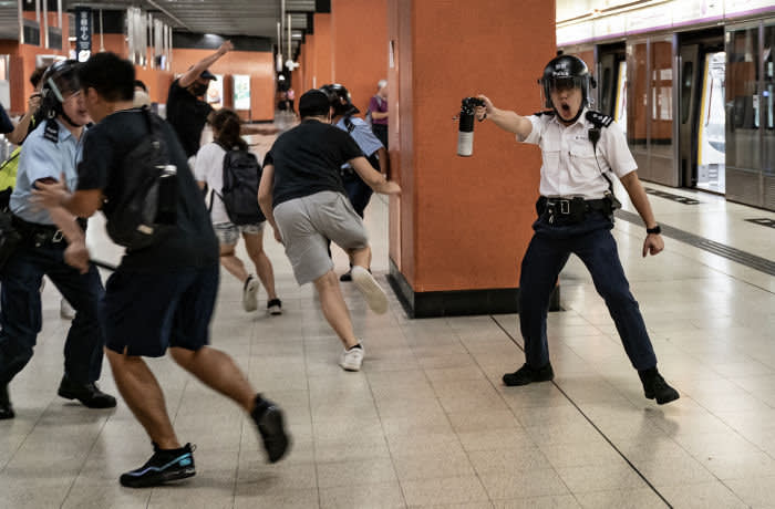 ***2019 News Images Of The Year*** - HONG KONG, CHINA - SEPTEMBER 5: A police officer holds up pepper spray as he attempts to disperse protesters out of the platform at Po Lam Station on September 5, 2019 in Hong Kong, China. Pro-democracy protesters have continued demonstrations across Hong Kong since 9 June against a controversial bill which allows extraditions to mainland China, as the ongoing protests, many ending up in violent clashes with the police, have surpassed the Umbrella Movement from five years ago and become the biggest political crisis since Britain handed its onetime colony back to China in 1997. Hong Kong's embattled leader Carrie Lam announced the formal withdrawal of the controversial extradition bill on Wednesday, meeting one of protesters' five demands after 13 weeks of demonstrations. (Photo by Anthony Kwan/Getty Images)