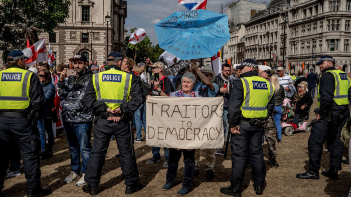 Police officers form a line in front of pro-Brexit demonstrators as anti-Brexit demonstrators gather nearby in Parliament Square in London, on Sept. 7, 2019. (Andrew Testa/The New York Times) Credit: New York Times / Redux / eyevine For further information please contact eyevine tel: +44 (0) 20 8709 8709 e-mail: info@eyevine.com www.eyevine.com