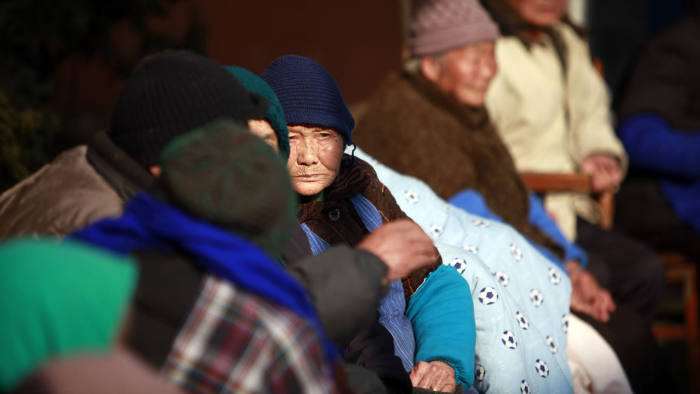 Residents warm themselves in the afternoon sun at the Luofu retirement home on the outskirts of Shanghai, China, on Tuesday, Dec. 13, 2011. Photographer: Qilai Shen/Bloomberg