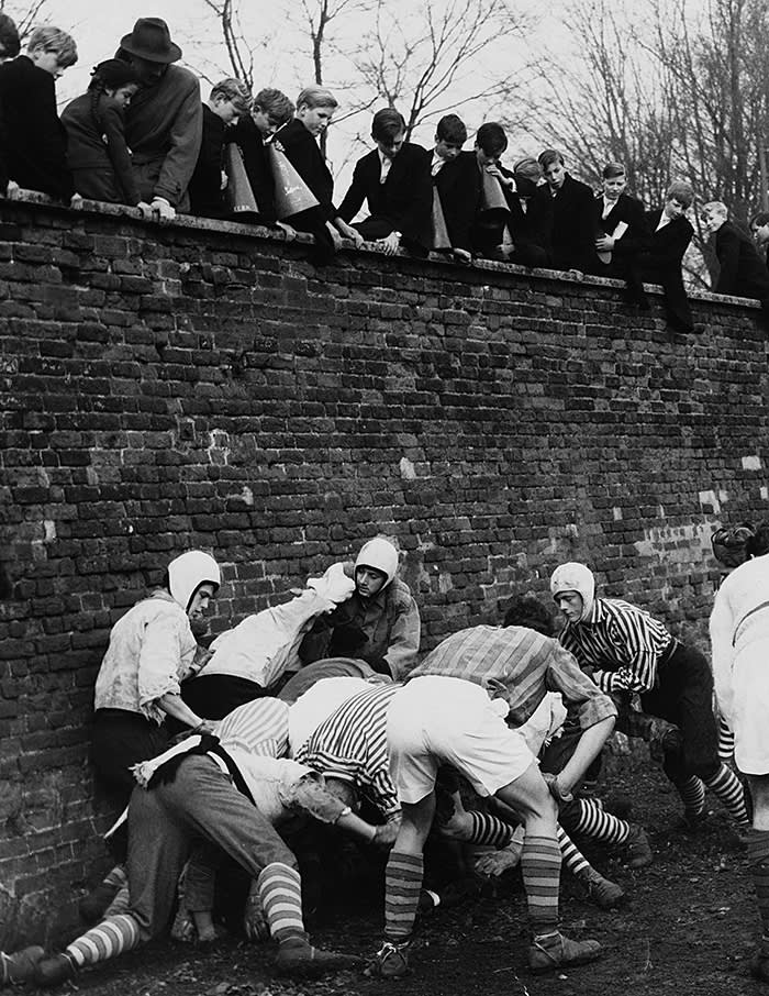 Boys watching the St Andrew's Day Wall Game at Eton, 1959. The school's enduring popularity with both traditional British and international families means it can balance its mix of students as it sees fit