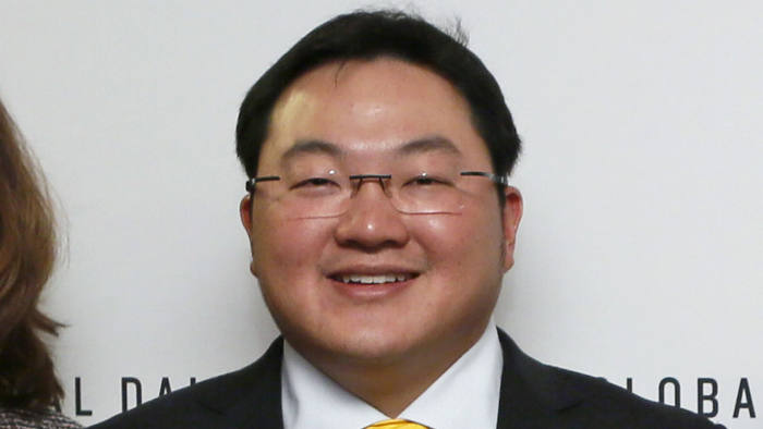 FILE - In this April 23, 2015 file photo, Jho Low, Director of the Jynwel Foundation, poses at the launch of the Global Daily website in Washington, D.C. The Justice Department on Thursday, Nov. 1, 2018, charged the fugitive Malaysian financier in a money laundering and bribery scheme that pilfered billions of dollars from a Malaysian investment fund created to promote economic development projects in that country. The three-count indictment charges Low Taek Jho, who is also known as Jho Low, with misappropriating money from the state-owned fund and using it for bribes and kickbacks to foreign officials, to pay for luxury real estate, art and jewelry in the United States and to fund Hollywood movies, including
