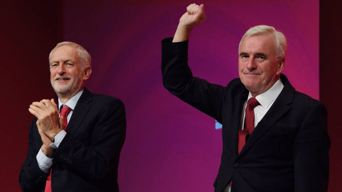 "LIVERPOOL, ENGLAND - SEPTEMBER 24: Labour Party leader Jeremy Corbyn looks on as Shadow Chancellor of the Exchequer John McDonnell receives applause following his address to delegates in the Exhibition Centre Liverpool during day two of the annual Labour Party conference on September 24, 2018 in Liverpool, England. Labour's official slogan for the conference is ""Rebuilding Britain, for the many, not the few"". (Photo by Leon Neal/Getty Images)"