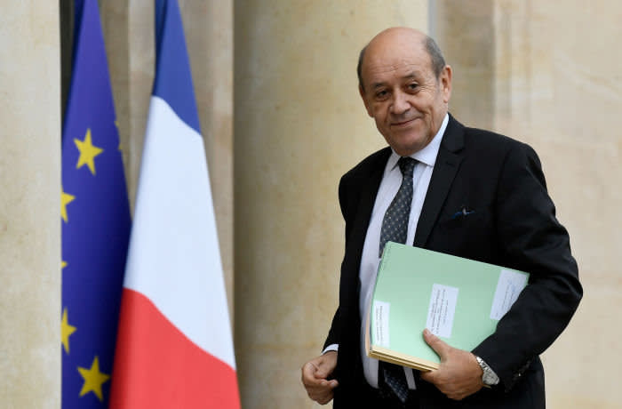 """(FILES) In this file photo taken on November 28, 2019, French Foreign Affairs Minister Jean-Yves Le Drian arrives to attend a meeting with NATO Secretary General Jens Stoltenberg (unseen) at the Elysee palace in Paris. - Seven people accused of having usurped the identity of the Minister of Foreign Affairs, Jean-Yves Le Drian, in order to swindle rich personalities, are to be tried in Paris on February 4, 2020. Among them is Gilbert Chikli, considered as the pioneer of the """"fake president"""" scams. (Photo by Bertrand GUAY / AFP) (Photo by BERTRAND GUAY/AFP via Getty Images)"""