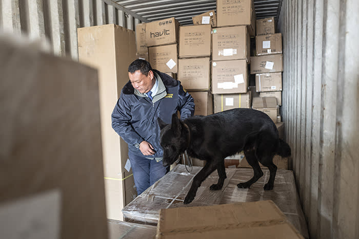 A freight container is searched for illegal shipments. Mongolia only has 34 customs sniffer dogs to cover an area the size of France, Germany and Spain combined