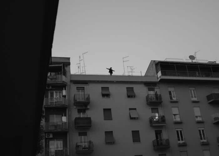 Three weeks into the lockdown, Romans seek escape and fresh air on apartment balconies and even the roof